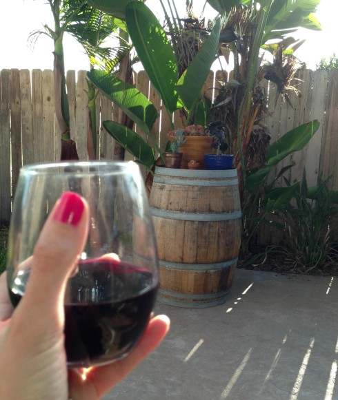 Cheers! Wine and a wine barrel plant stand