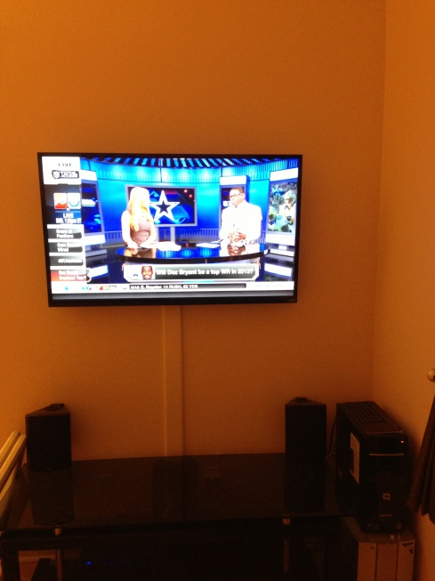 TV mounted on wall
